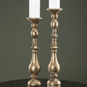 Höga golvljusstakar för blockljus i guldbrun metall