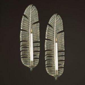 Väggljusstake i metall med plats för kronljus