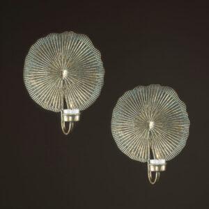 Väggljusstake i metall med plats för värmeljus