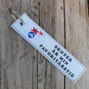Skoter är min favoritårstid nyckelring ledkryss