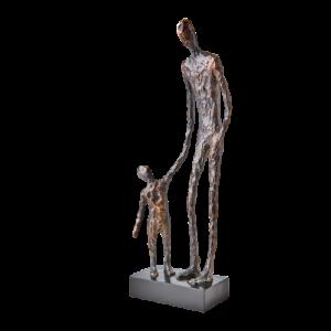 staty brons svart vuxen barn håller i hand